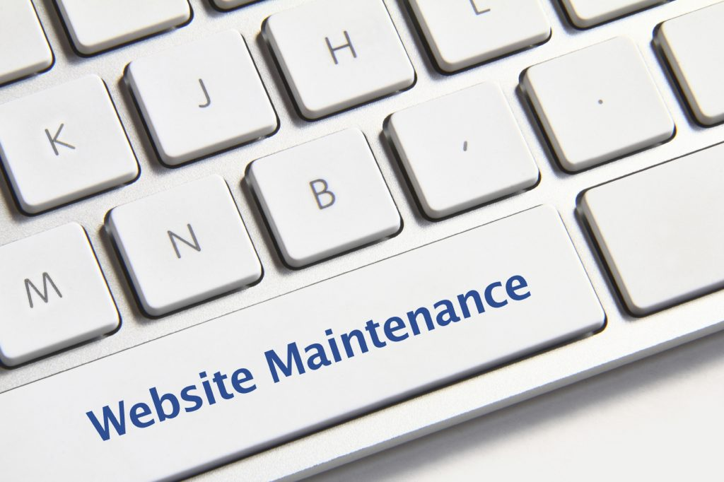 Website maintenance icon on white keyboard button